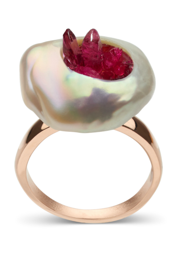 A lovely pink freshwater souffle pearl is carved and filled with reclaimed rubies set on 14K gold. This beautiful pearl ring is by little h.