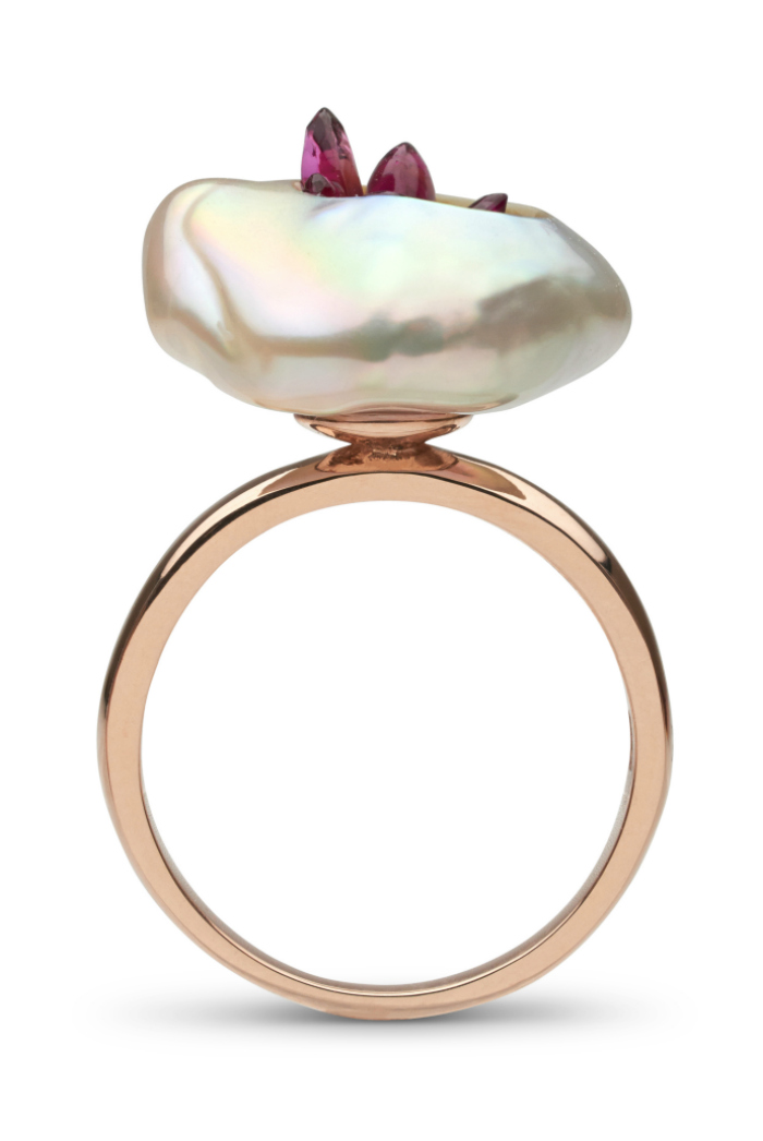 A pink freshwater souffle pearl is carved and filled with reclaimed rubies set on 14K gold. This beautiful pearl ring is by little h.