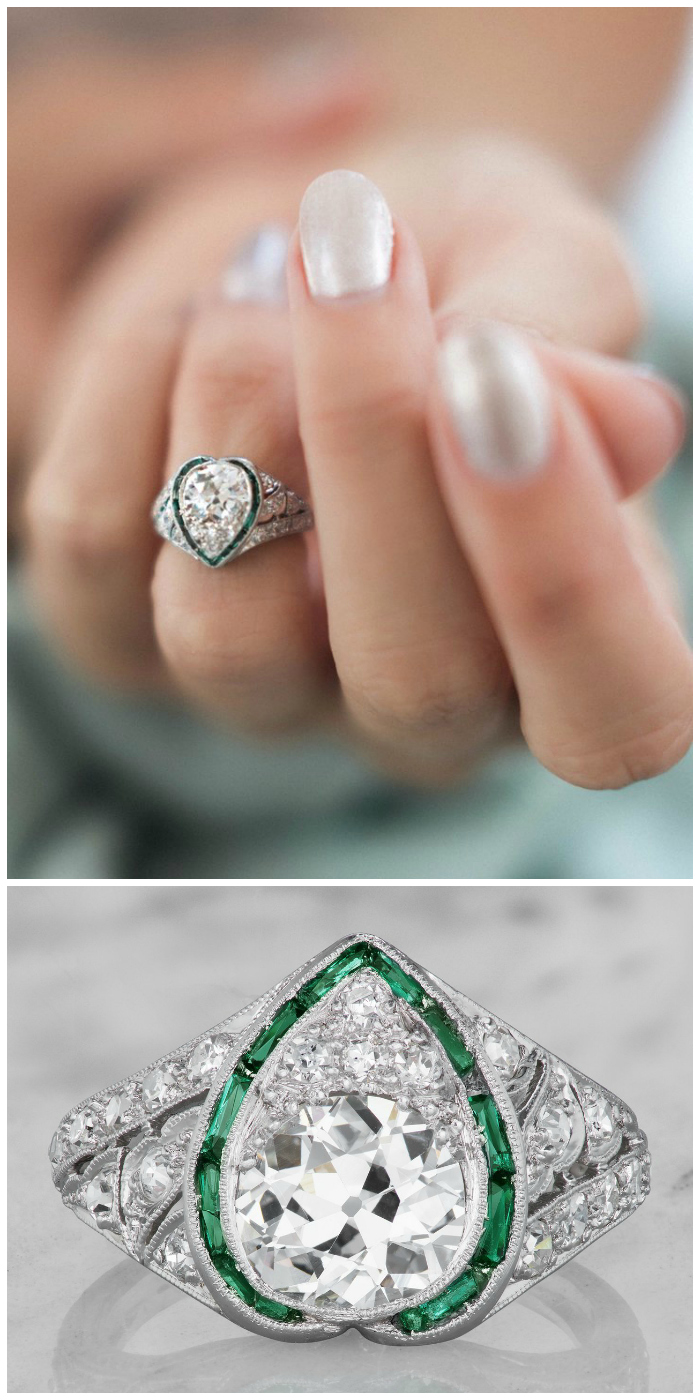 The Lolita ring is a stunning vintage heart engagement ring from the Art Deco Era, circa 1920! This beautiful creation centers a 1.07 carat old mine cut diamond in a halo of emeralds.