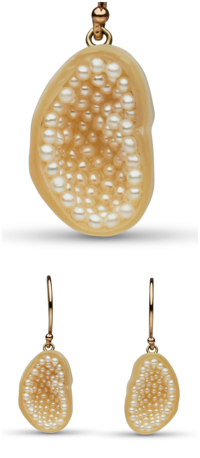 These amazing pearl earrings by little h feature white freshwater souffle pearls sliced and lined with tiny seed pearls, set in 14k gold.