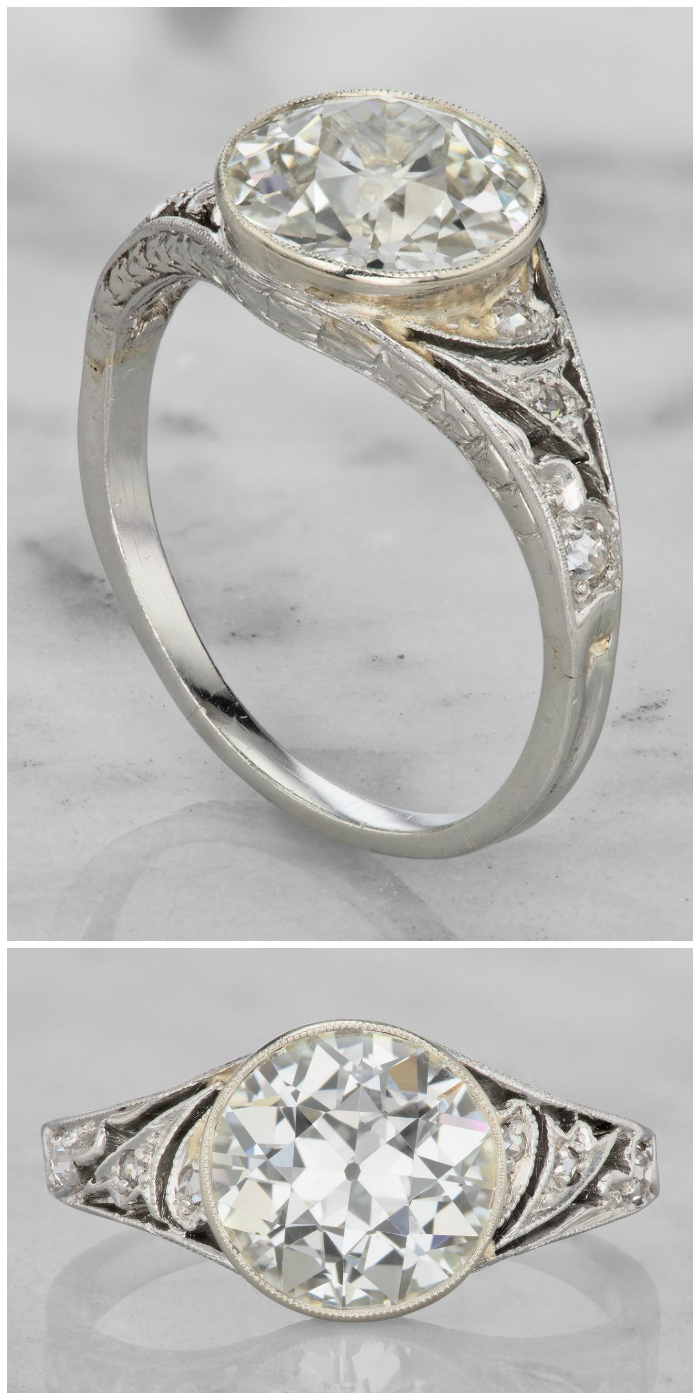 This beautiful vintage engagement ring is from the 1930's. It's platinum, with a beautiful bezel set 2.18 carat old European cut diamond.