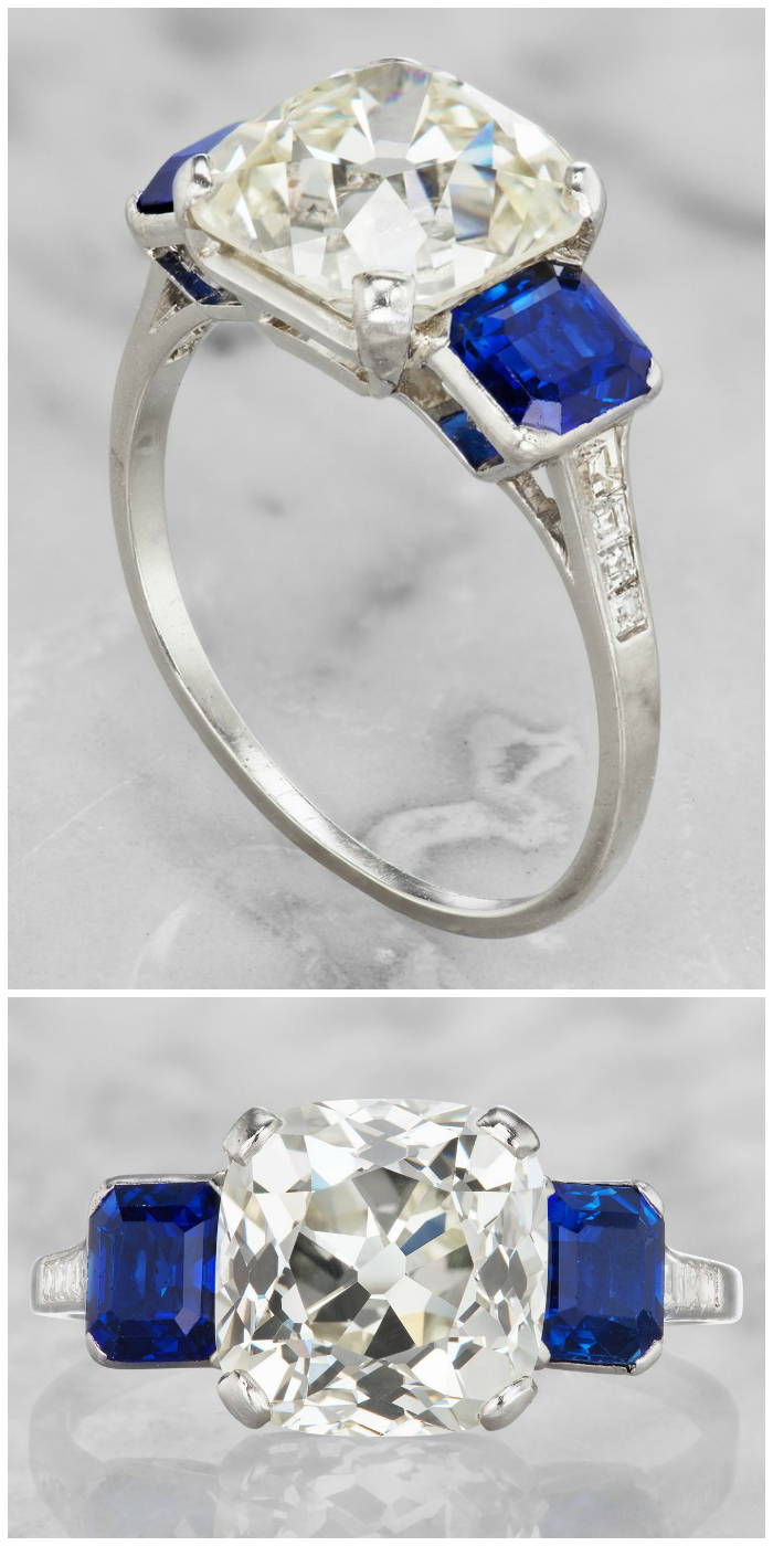 This glorious vintage Art Deco era engagement ring features a magnificent 4.21 carat old mine cut diamond between two no-heat blue sapphires