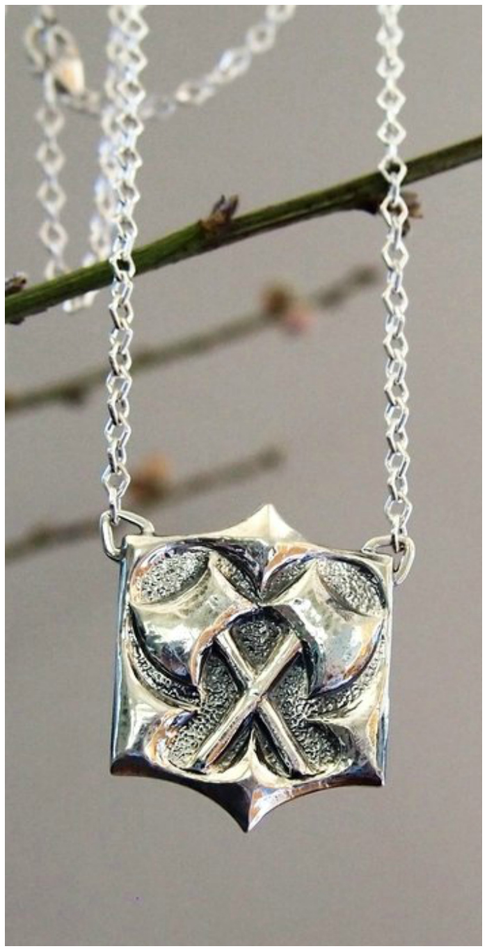 Kristen Dorsey's Hatchet pendant in sterling silver. The Hatchet Women collection is inspired by an incredible true story.