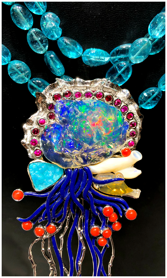 Detail view of an incredible Paula Crevoshay necklace that depicts a beautiful Portuguese Man o' War jellyfish in opal, chrysocolla, sapphire, and coral.