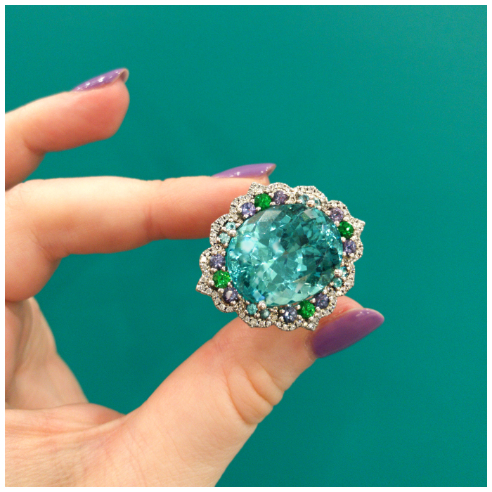 The Mermaid ring by Campbellian Collection! A huge and beautiful tourmaline with pretty green garnets and lavender sapphires.