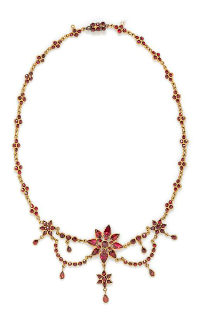 A Victorian gilt silver bohemian garnet swag necklace.