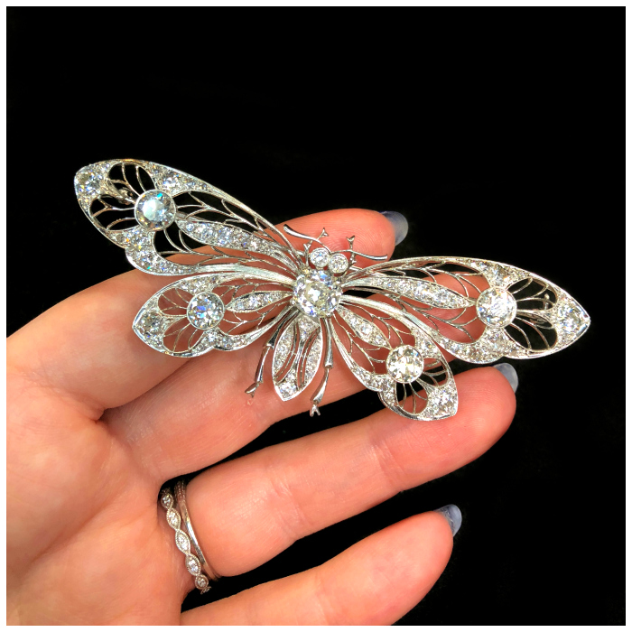An incredible platinum and diamond butterfly or moth brooch from DK Bressler. Platinum with diamonds.