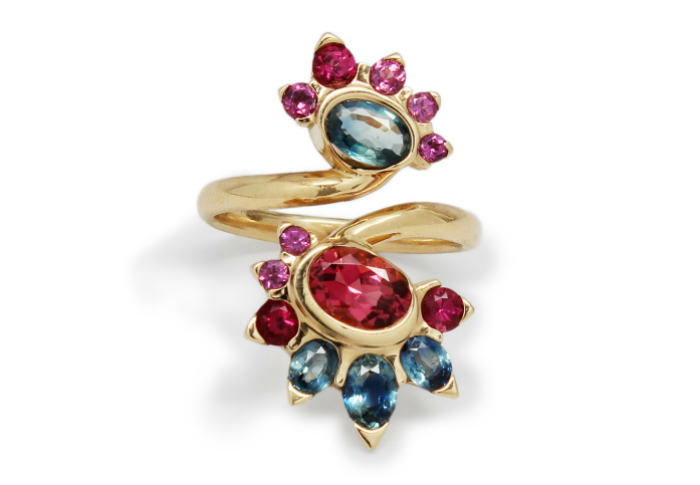 This one of a kind Baker & Black ring features rubellite tourmaline, blue sapphires and rhodolite garnet in 18 karat yellow gold, made in NYC.