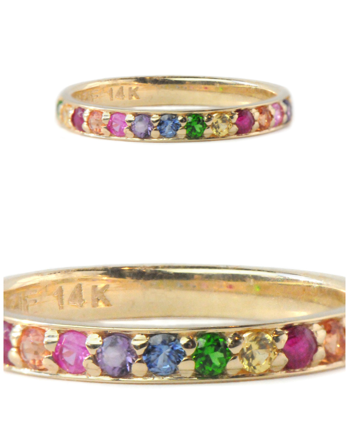 A multicolored rainbow gemstone ring by Anzie. This would make a great wedding band or stacking ring.