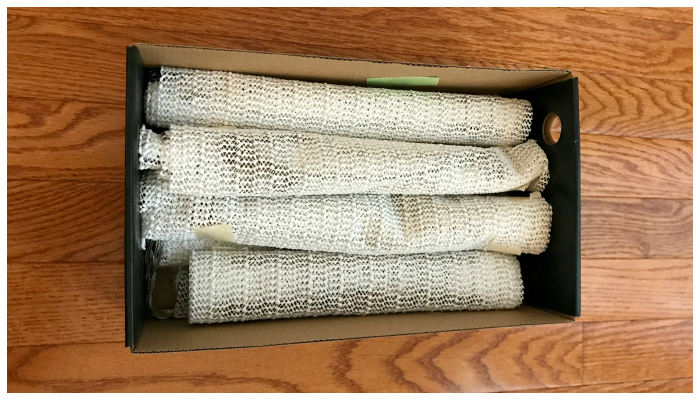 Necklaces rolled up in shelf liner and packed carefully in a shoe box!! This is my new favorite way to pack necklaces.