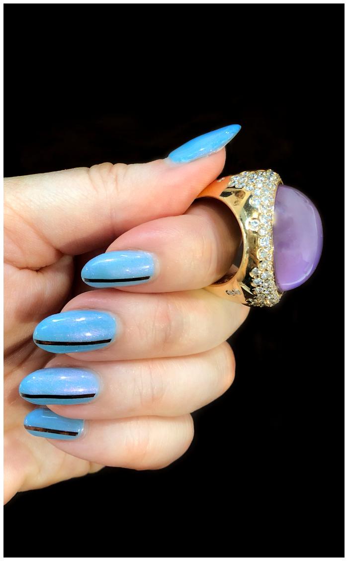 A wonderful gemstone and diamond ring by gioielliamo! Beautiful Italian design.
