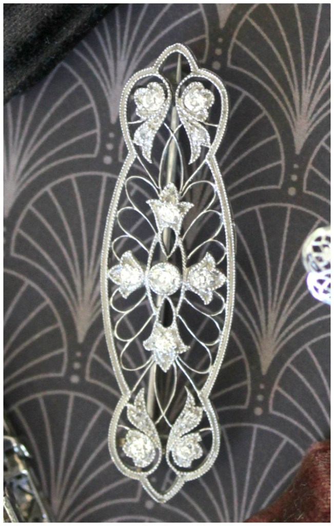 A wonderfully lovely filigree and diamond brooch. Art Deco era, from Market Square Jewelers.