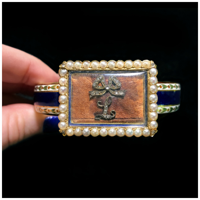 A truly stunning antique locket bracelet from Jane Fletcher's collection! Enamel, pearls, a piece of fabric, and a diamond initial....and a secret message inside!