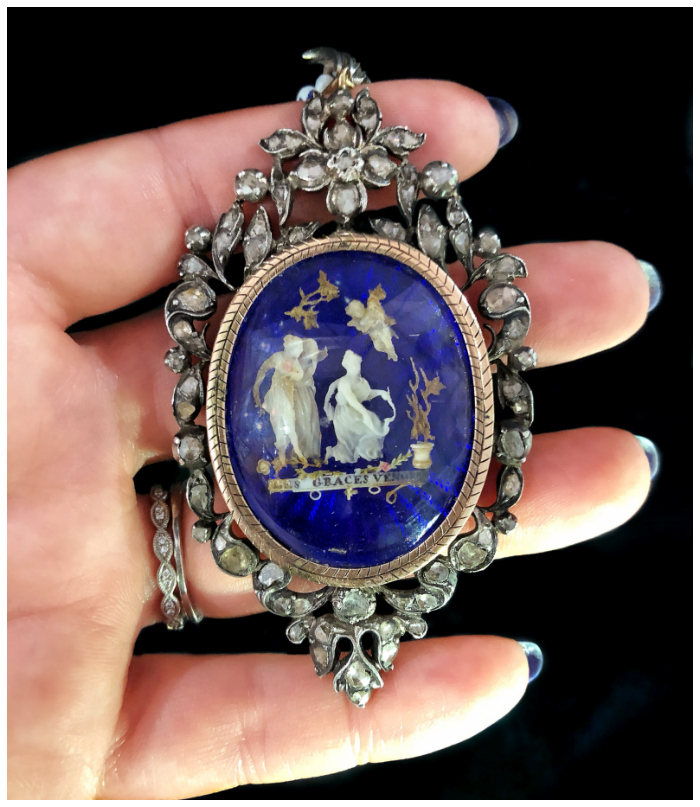 An exquisite, intricate Georgian era pendant showing a tiny ivory scene with the Three Graces. At Roy Rover Antiques.