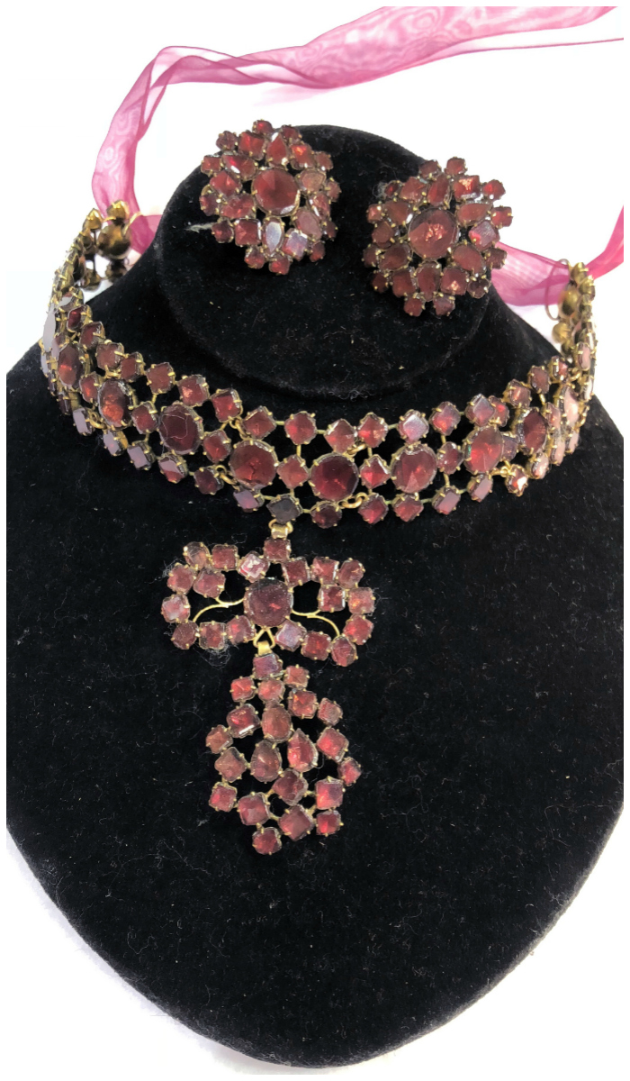 An incredible and rare Queen Anne flat cut garnet and gilt metal necklace and earring set, circa 1750. From Spare Room Antiques.