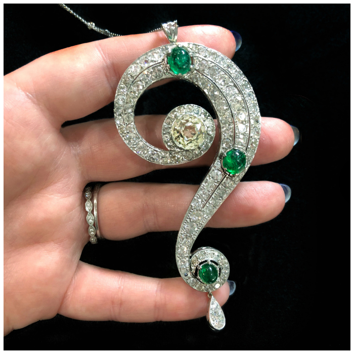An utterly stunning Art Deco era necklace pendant in the shape of a question mark! With diamonds and cabochon emeralds. At Pam Benson.