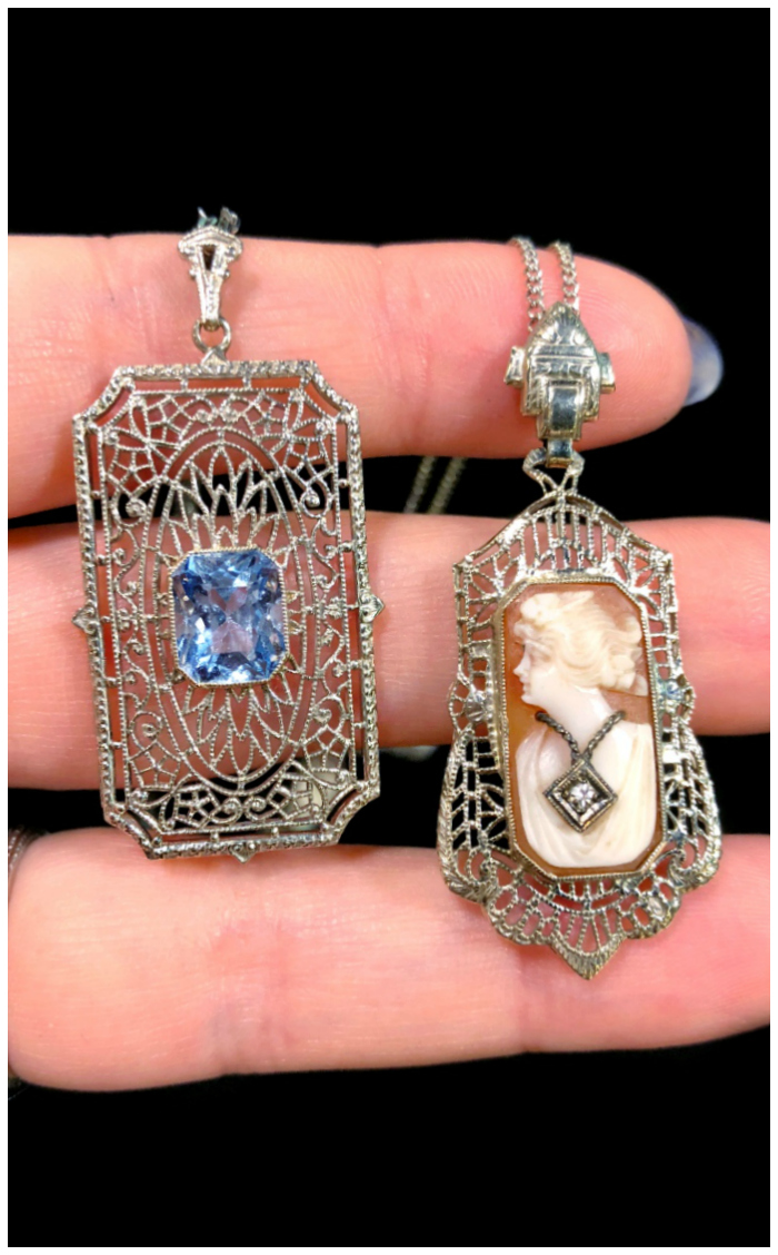 Two beautiful antique necklaces from The Gold Hatpin, one sapphire and one cameo in Art Deco filigree settings.