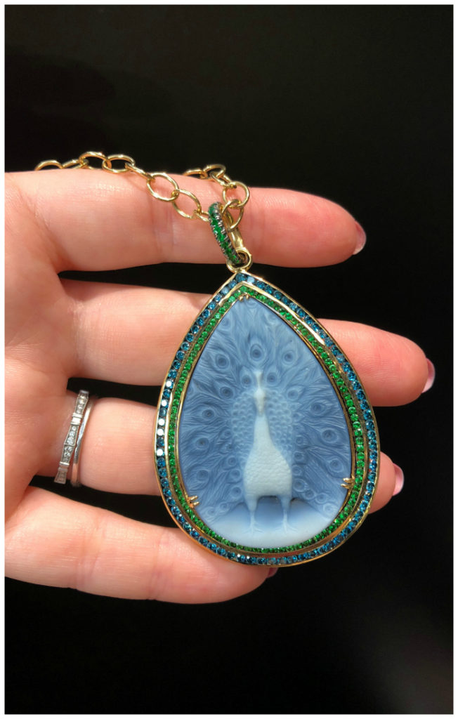 A beautiful peacock cameo necklace by Syna Jewels. With Tsavorite garnets and blue diamonds.