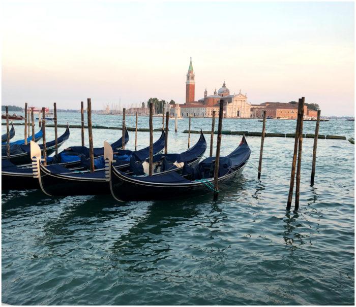 Gondolas at sunset in Venice, Italy.