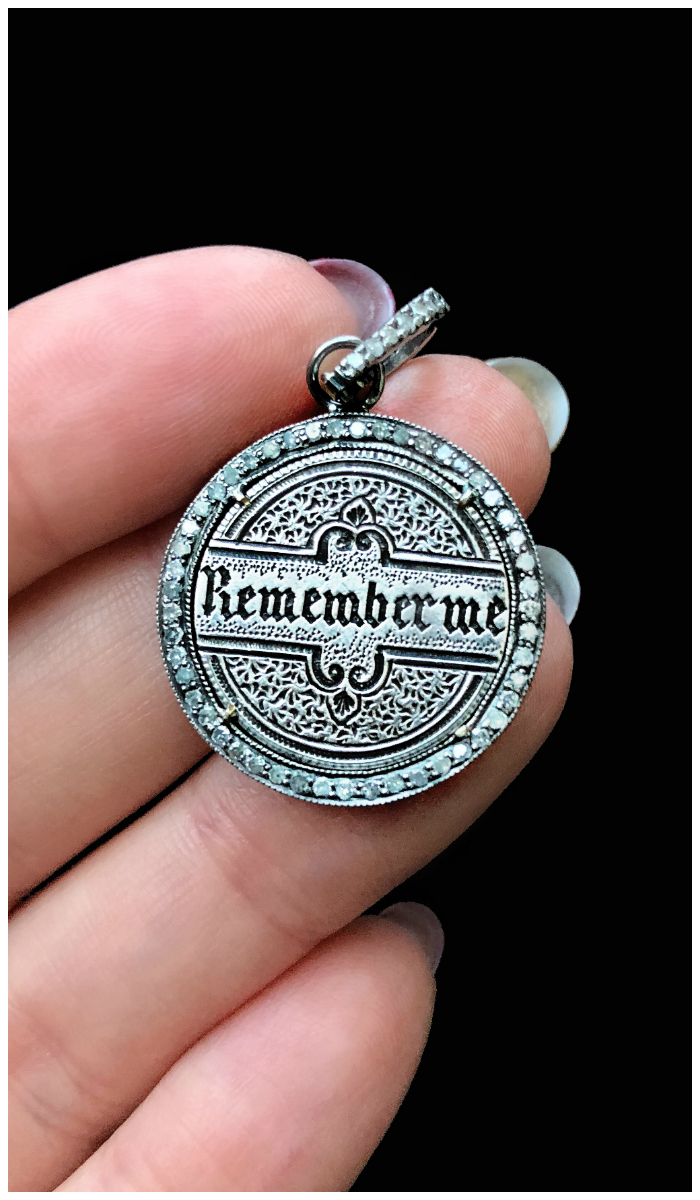 An extraordinary Victorian era love pendant token by Heavenly Vices! This one says 'Remember me' in black enamel, with diamonds.