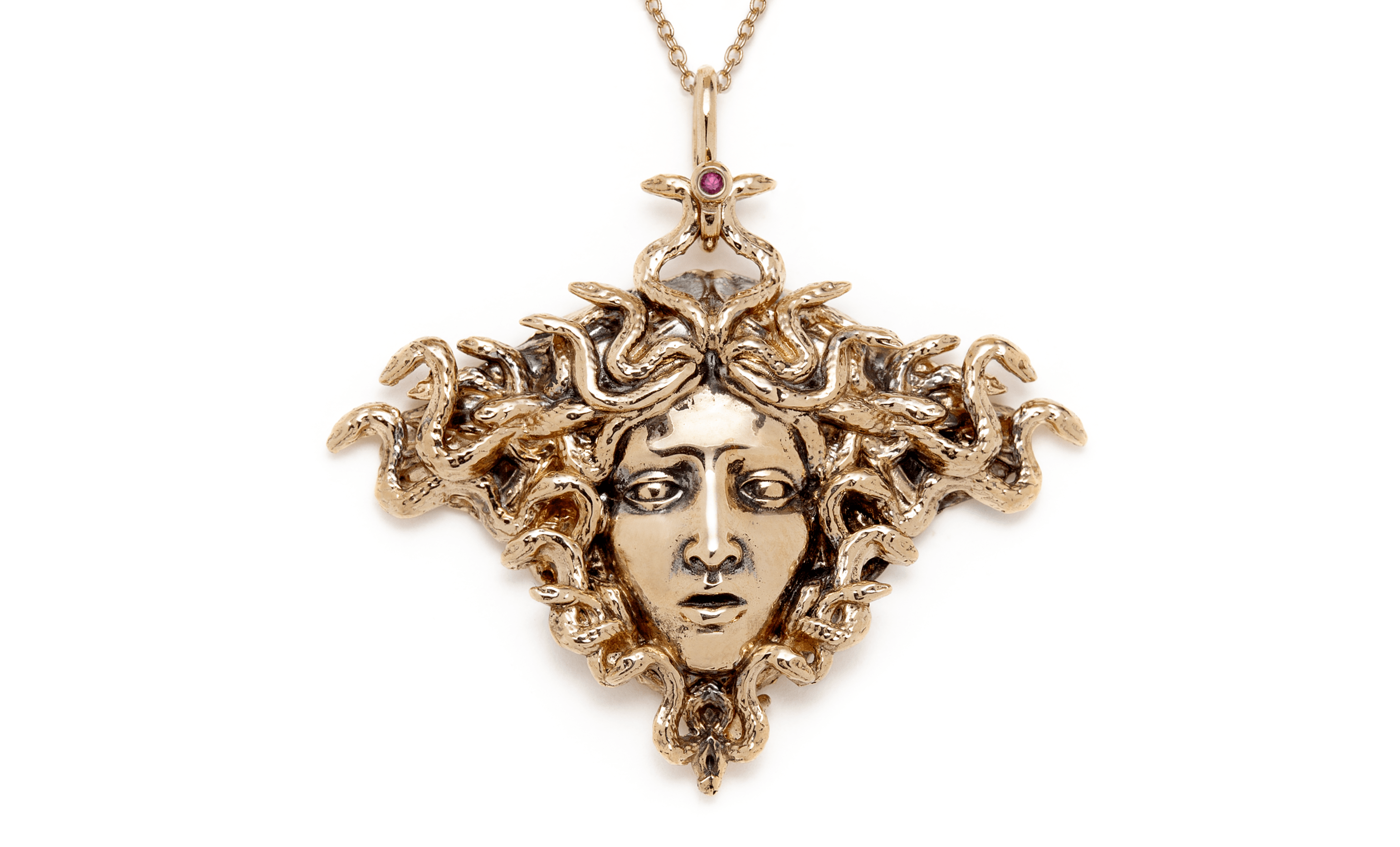 The magnificent Medusa pendant necklace by Sofia Zakia. Handmade in 14K yellow gold with a ruby.