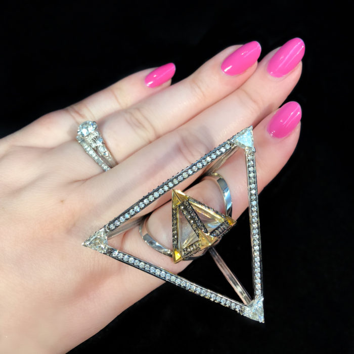 The stunning pyramid ring from Bia Tambelli's Trinity collection. Gold and diamonds with rock crystal, citrine, and rubies.