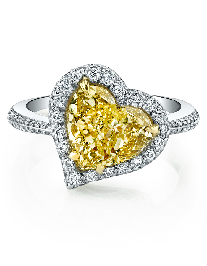 A magnificent yellow diamond engagement ring. Love that heart shaped diamond!
