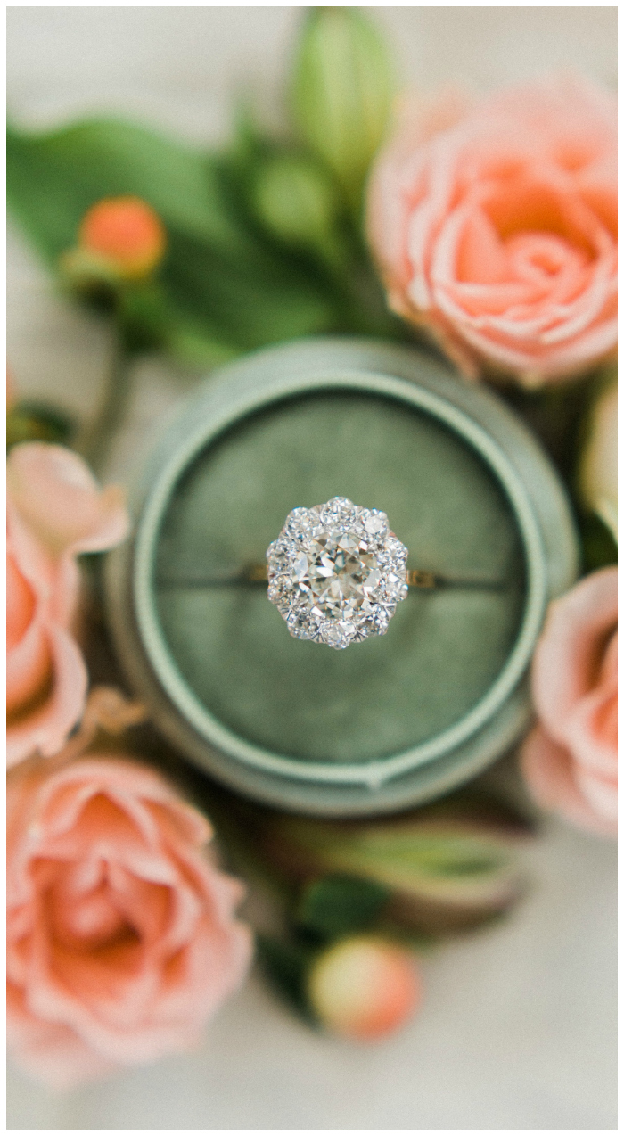 This vintage engagement ring from the Edwardian era features a 2.21 carat old European cut diamond with another 1.75 carats of diamonds around it.