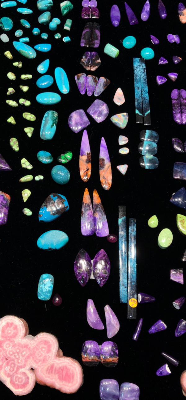 A colorful array of gemstones from Azurz at the 2019 AGTA GemFair in Tucson.