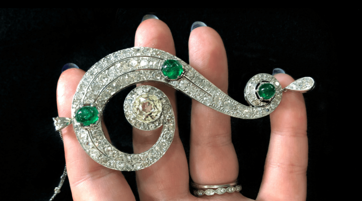 This is a magnificent Art Deco era emerald and diamond question mark necklace, from Pam Benson.
