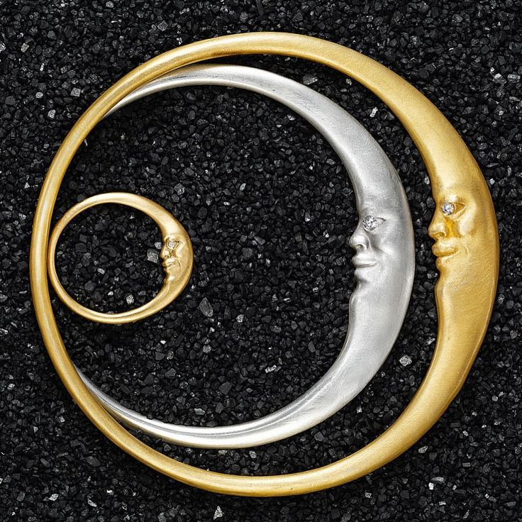 Dreamy moonface ring and bracelets by Anthony Lent.