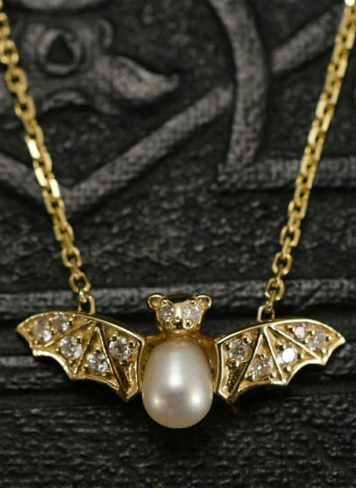 I love this bat necklace!! Pearls and diamonds in gold, from Erica Weiner.