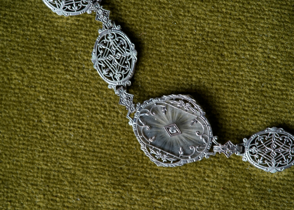 I love the beautiful details on this Art Deco era camphor glass and white gold filigree bracelet.