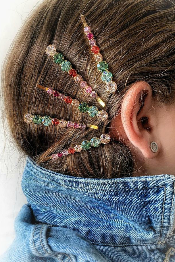 I love this hair jewel style from Lelet NY! Colorful barettes around the ear.