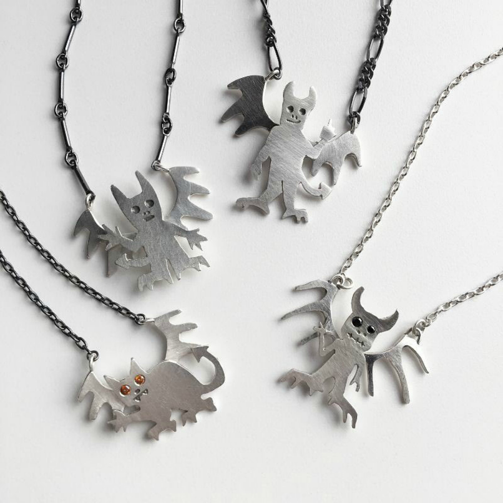 Susan Elnora demon necklaces in silver with gemstone eyes.