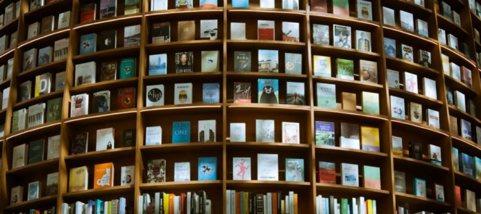 What I'm reading. Photo of bookshelves by Yury Nam on Unsplash