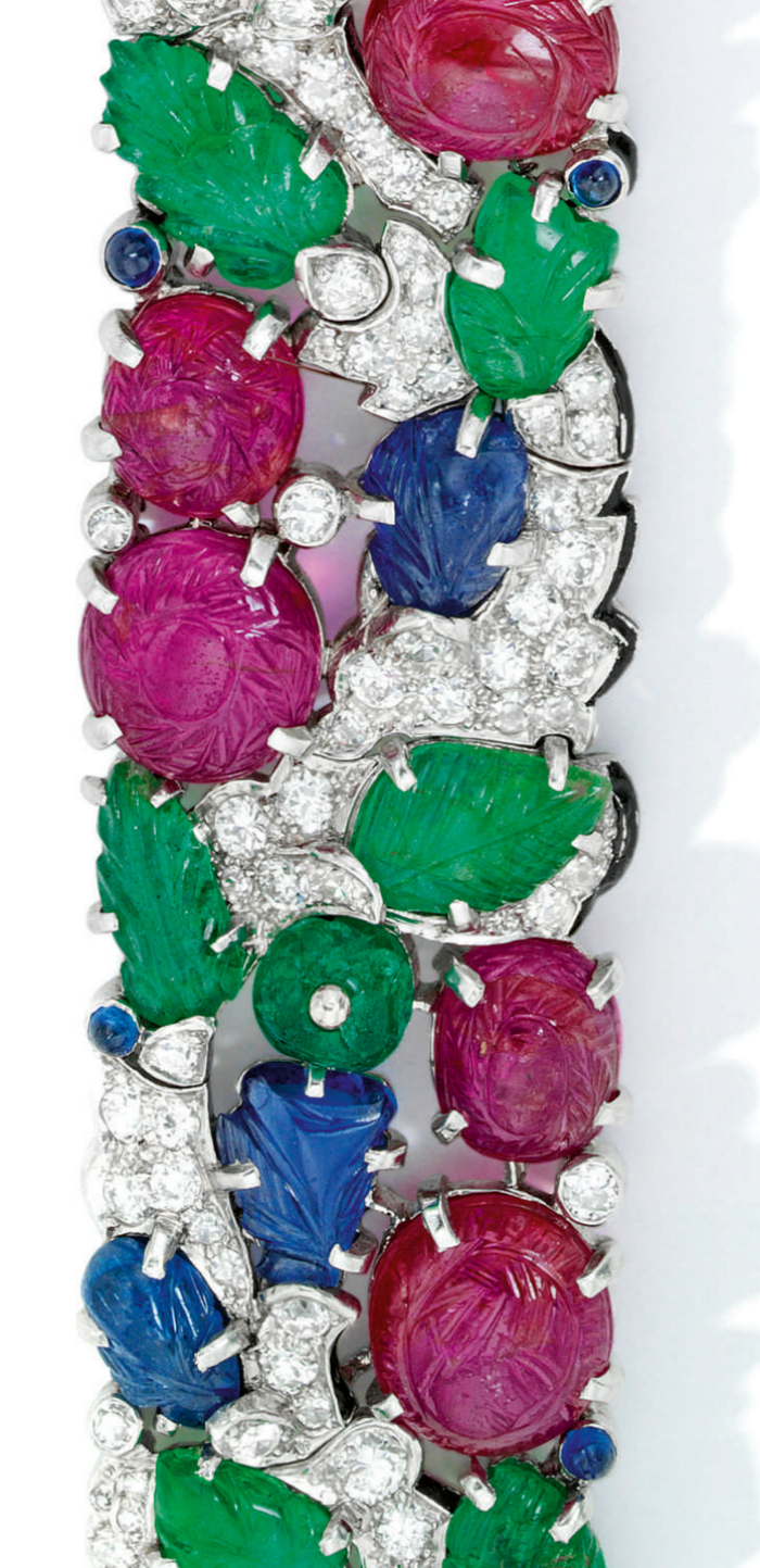 Close up view of a rare Art Deco Cartier Tutti Frutti bracelet, circa 1930. Diamonds with carved rubies, emeralds, and sapphires.