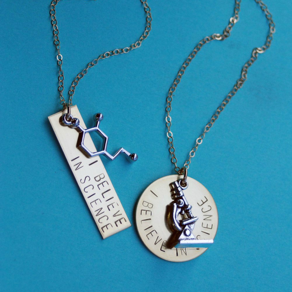 I Believe in Science necklace by Bang-Up Betty, with molecule or microscope.