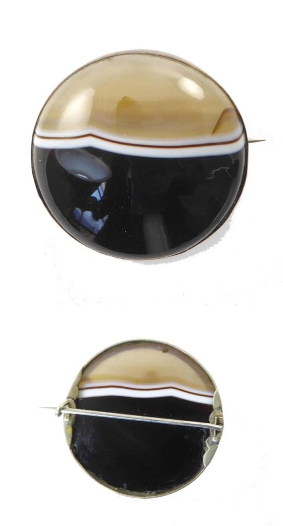 A Victorian era banded agate brooch. From Lisa Kramer Vintage.