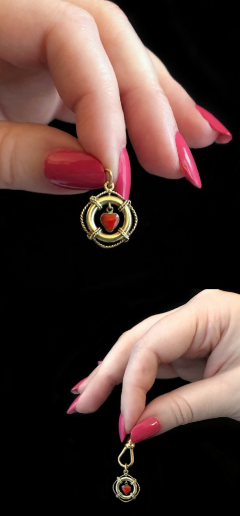 A wonderful vintage charm of a life preserver in gold with an enamel heart. By Sloan and Co., from Wilson's Estate Jewelry.