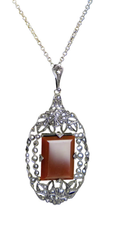 Art Deco era sterling silver pendant with marcasite and carnelian. From ccFindds on Ruby Lane.