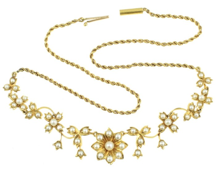A beautful gold and seed pearl flower necklace, Edwardian ear. From Carus Jewellery.