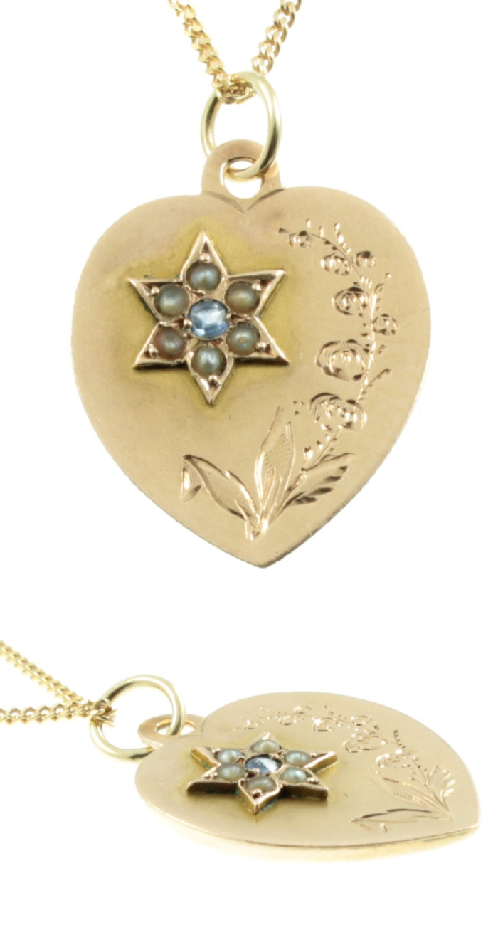 A beautiful Edwardian era gold pendant with a star with a diamond and pearls and a floral design. From Carus Jewellery.