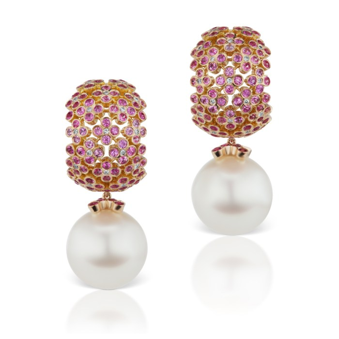 The hydrangea earrings by Alexia Connellan. Pink sapphires and diamonds in pink and peach gold with South Sea pearls.