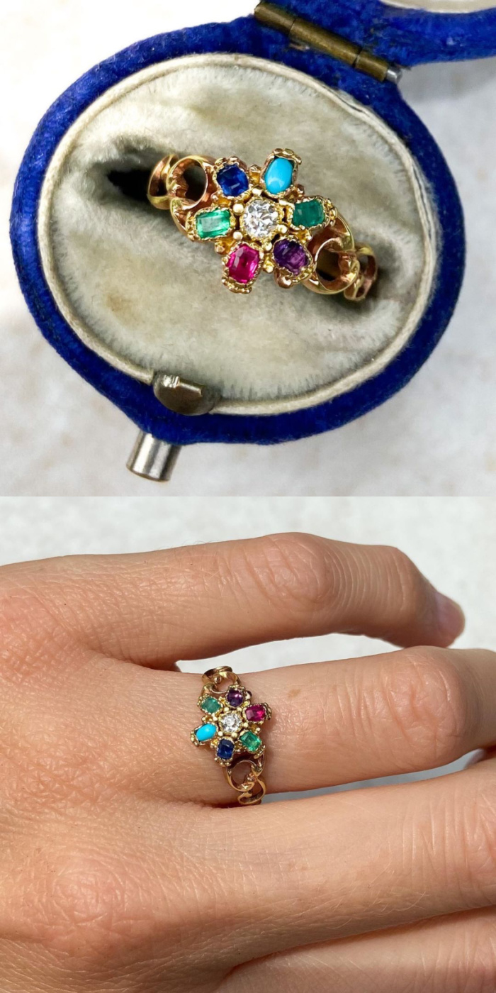 Antique gold acrostic ring from the Victorian era. The gems in the flower spell out DEAREST. From Audrey & Wolf.