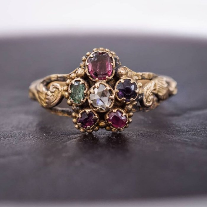 Early Victorian acrostic ring in pansy form, circa 1830. The gems spell out REGARD, a message of love. From Nalfie's.