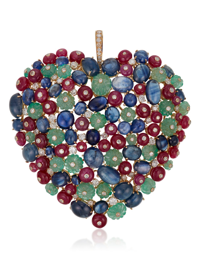 Heart pendant by Michele della Valle with round diamonds, carved emerald beads, sapphire cabochons, ruby beads, and 18k yellow gold. At Christie's.