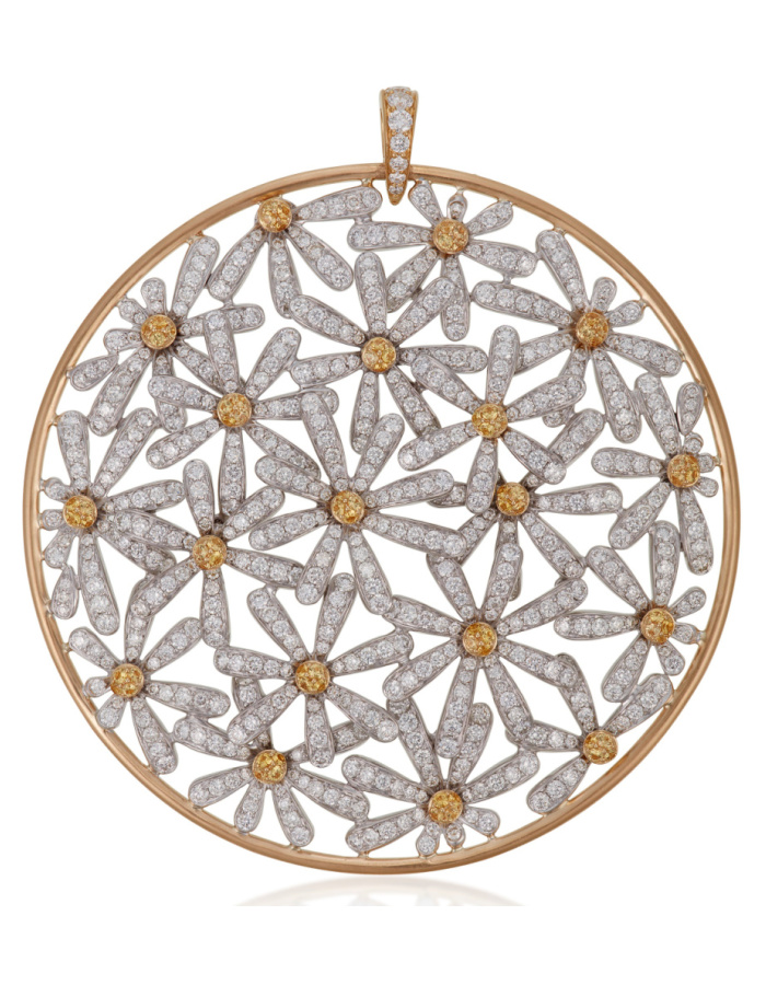 This flower pendant by Michele della Valle features bright diamond flowers with yellow sapphire centers.