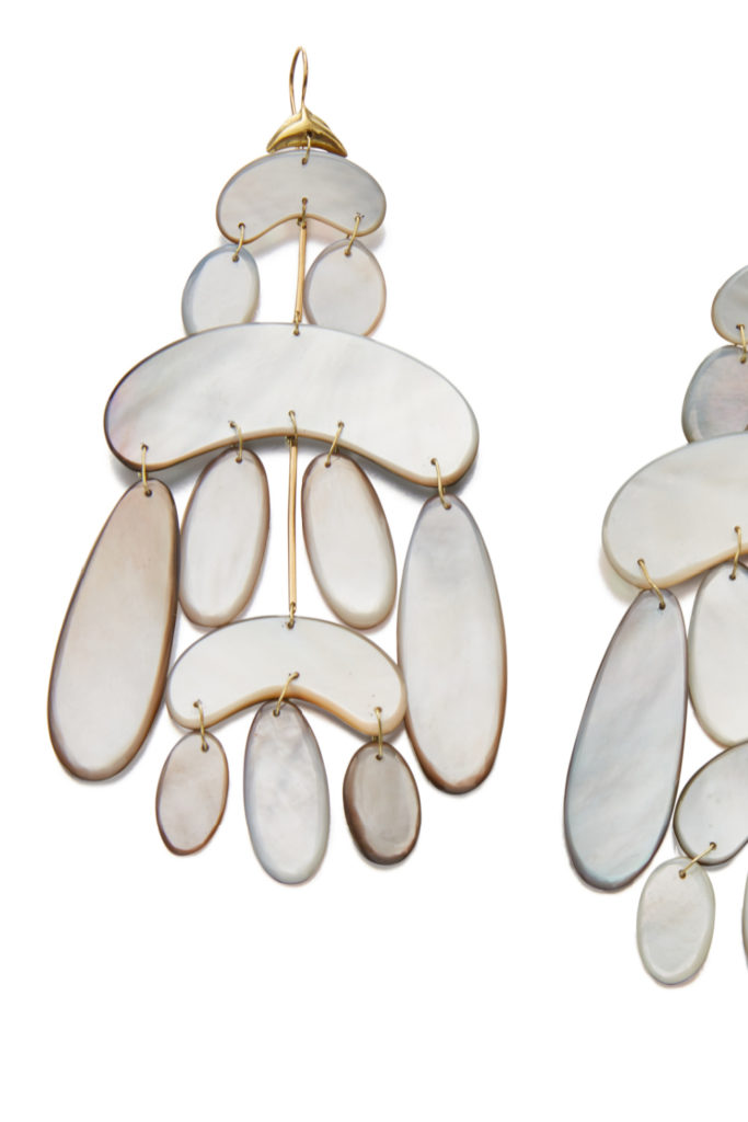 Mother of pearl and gold earrings by Tenthousandthings, from Sotheby's Brilliant & Black, an exhibition of work by Black jewelers