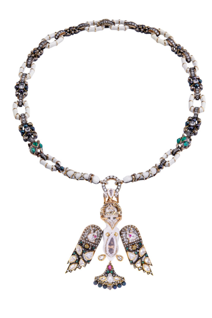 The Bisque Doll necklace by Castro has a convertible chain, so it can be worn either long or short. This is the short version.